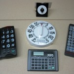 Phones, calculator and TV remote display
