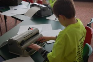 Student typing on Braille writer
