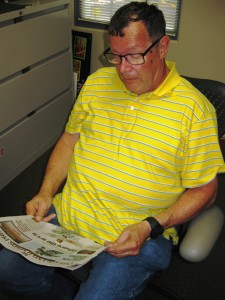 Peter reading a newspaper