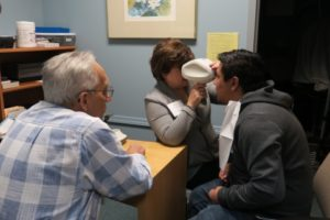 Staff member conducting vision screening