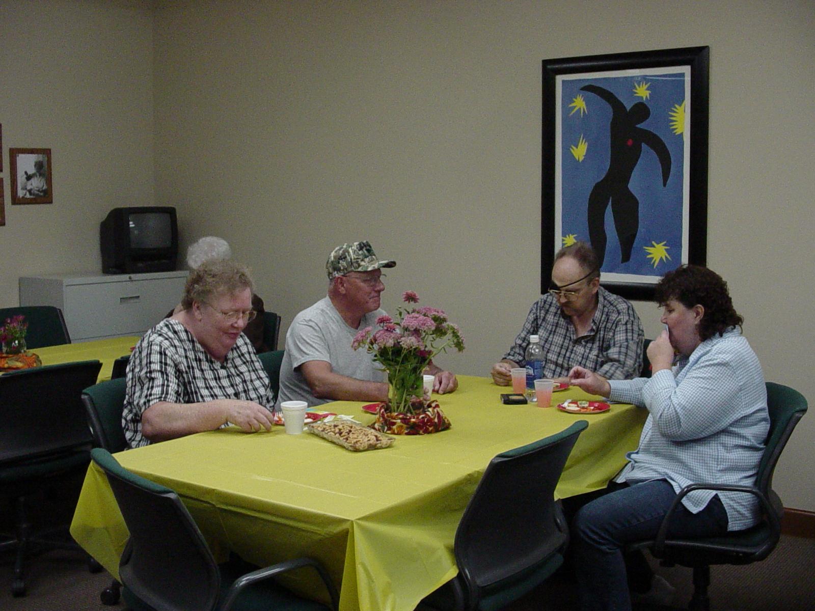 Group of volunteers enjoy a meal together